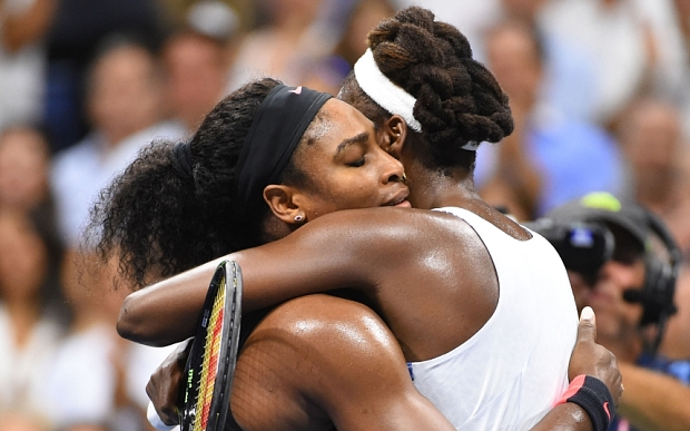 Serena and Venus in a heartfelt hug after the match is over